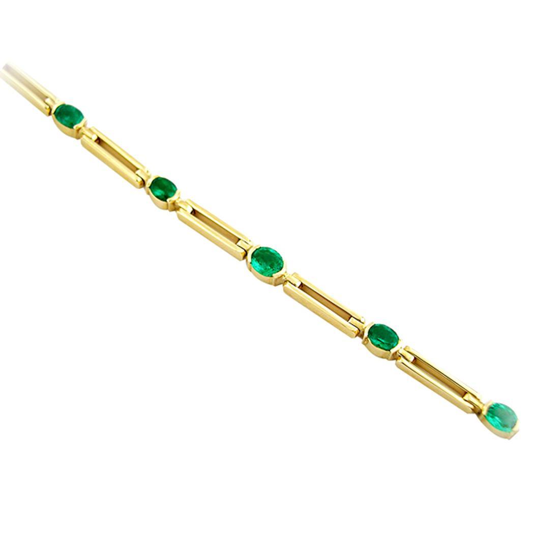 9 Oval Shaped Natural Emeralds Set in 18K Gold Bracelet With Long Links