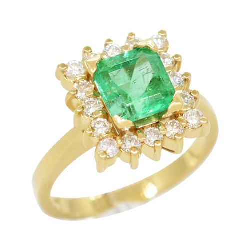 Emerald Cut Emerald Set in 18K Gold Ring With Diamond Halo in Cocktail Ring Style