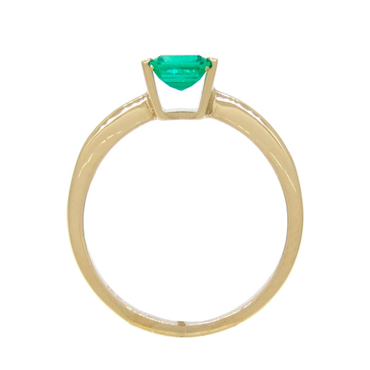 emerald-cut-emerald-solitaire-ring-in-18k-yellow-gold-tension-setting-ring-style