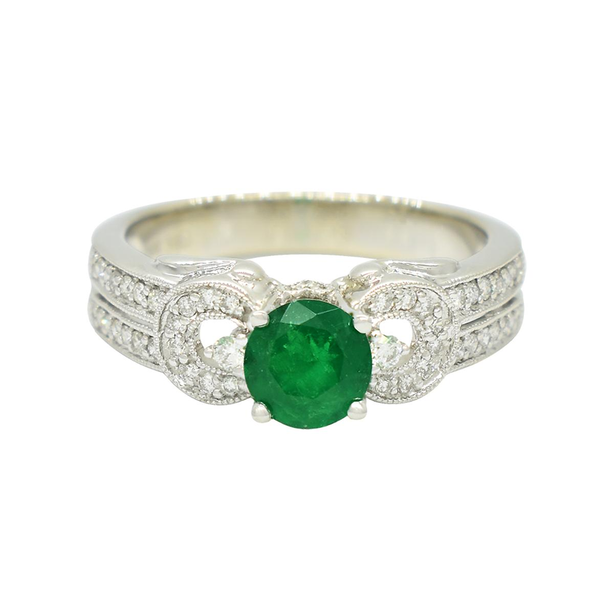 emerald-ring-in-14k-white-gold-with-44-round-diamonds-in-micro-pave-setting